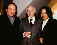 "The artist and his wife Suyu with French singer-songwriter Charles Aznavour, considered ""the ambassador of French song,"" and Gabriel Tortella, founder of the Swiss magazine Tribune des Arts, during his solo exhibition at the Charlotte Moser Gallery."